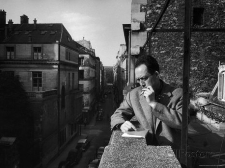 loomis-dean-french-writer-albert-camus-smoking-cigarette-on-balcony-outside-his-publishing-firm-office