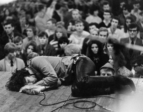 Jim Morrison laying on stage during a performance of The Doors. Frankfurt, Germany, September 1968.
