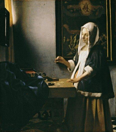 jan_vermeer__woman_holding_a_balance1332615895567